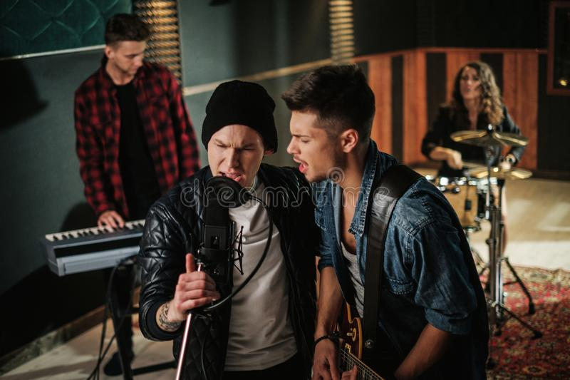 Music band having rehearsal in a studio.  royalty free stock photos
