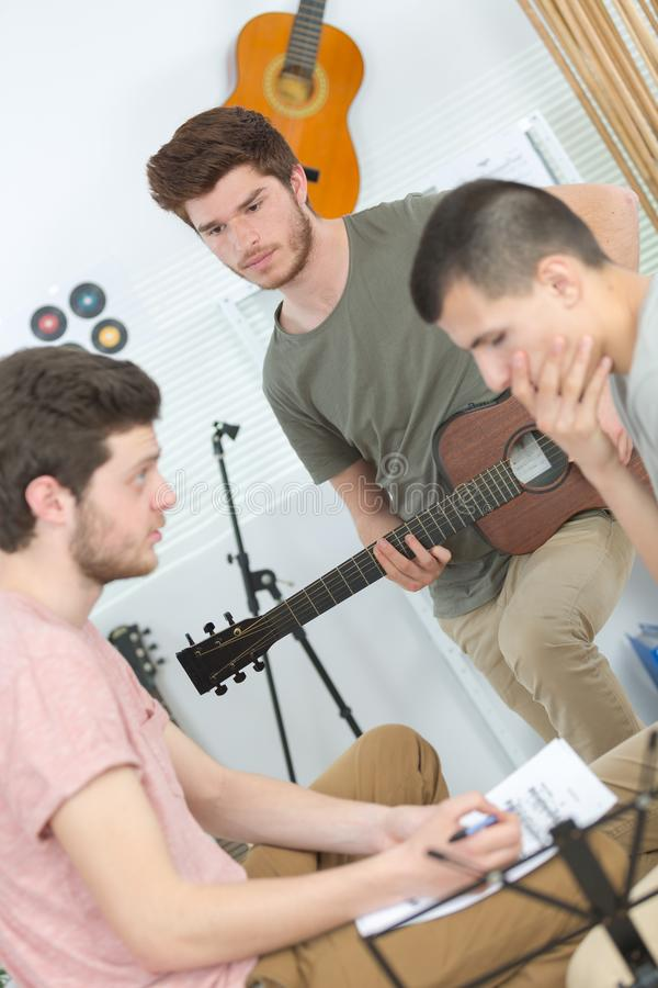 Music band performing at home. Friends royalty free stock images