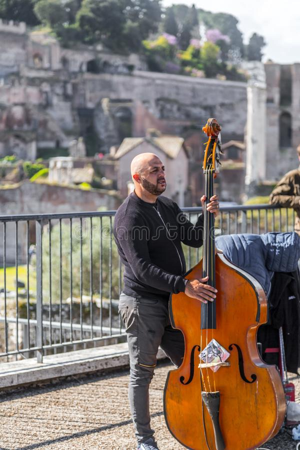 Music band performing a public concert in Rome stock photo