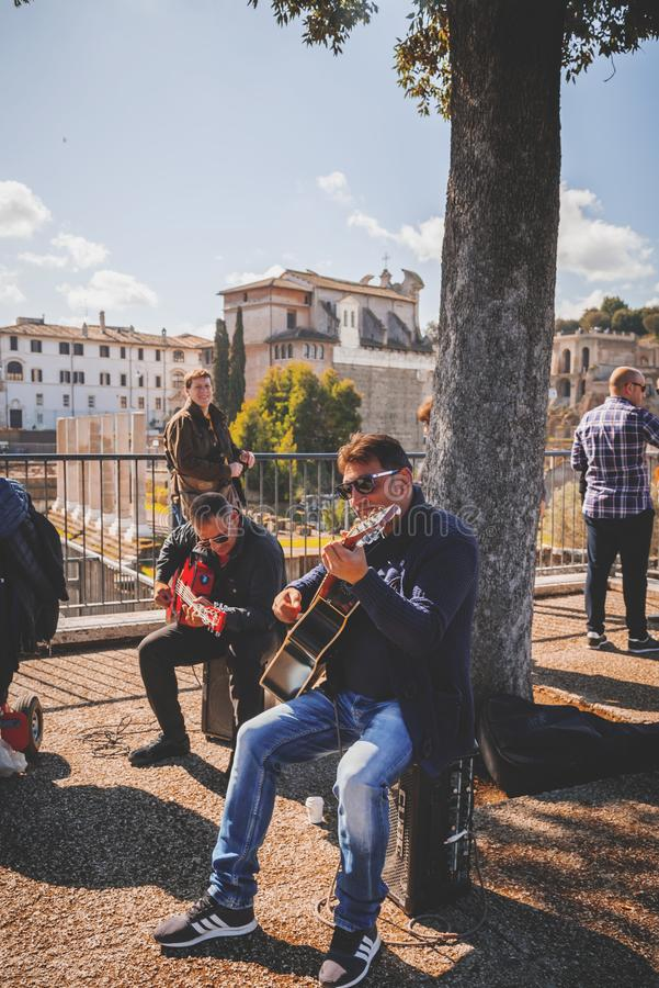 Music band performing a public concert in Rome. Rome, Italy - April 5, 2019: Music band performing a public concert next to the ancient Roman Forum in Rome royalty free stock photography