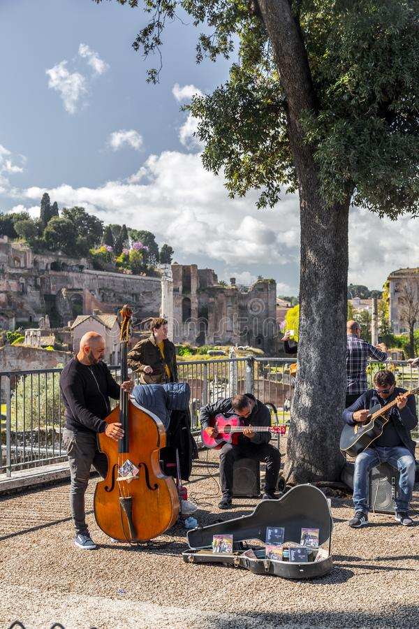 Music band performing a public concert in Rome. Rome, Italy - April 5, 2019: Music band performing a public concert next to the ancient Roman Forum in Rome stock images