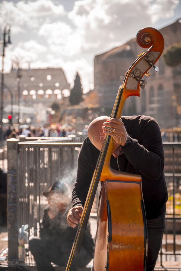 Music band performing a public concert in Rome. Rome, Italy - April 5, 2019: Music band performing a public concert next to the ancient Roman Forum in Rome royalty free stock photos