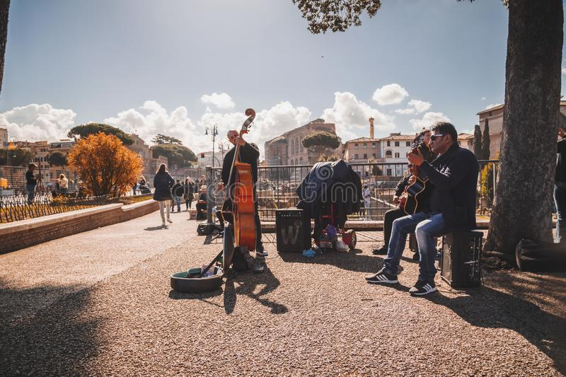 Music band performing a public concert in Rome. Rome, Italy - April 5, 2019: Music band performing a public concert next to the ancient Roman Forum in Rome stock photos