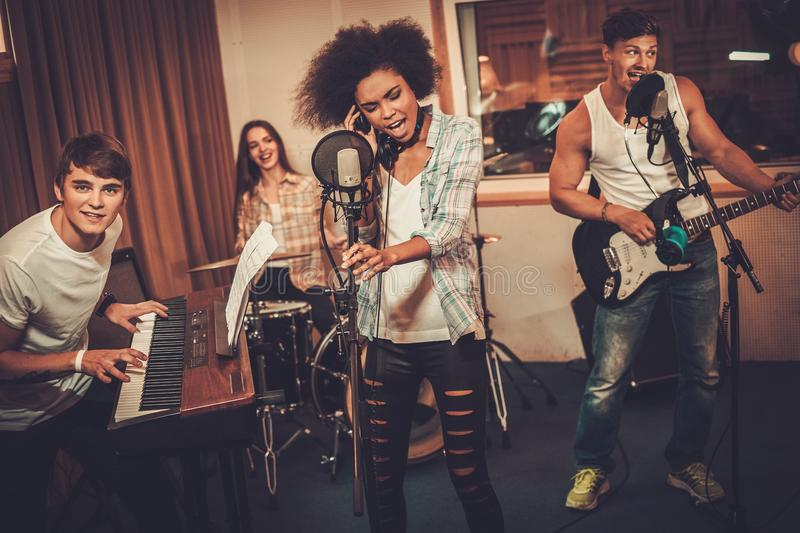 Music band performing in a studio stock photo