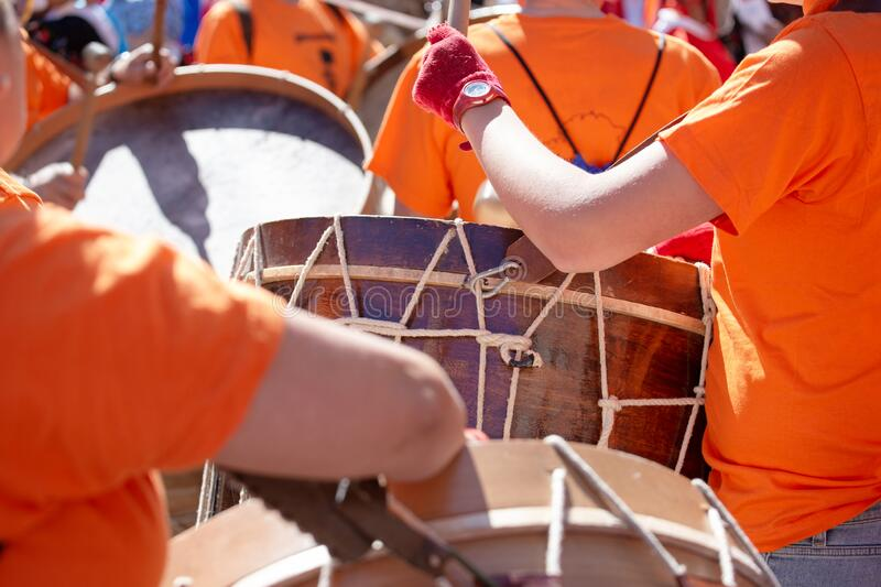 Music band playing a bass drum. During an outdoor festival. Spanish culture stock image