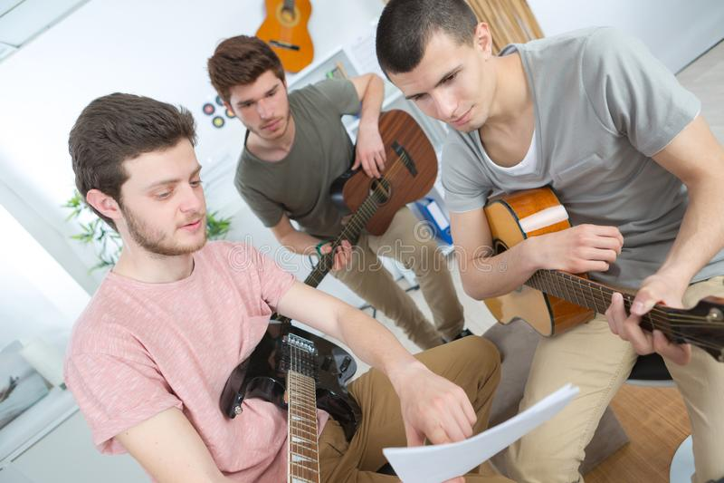 Music band rehearsing at home. Teen stock image
