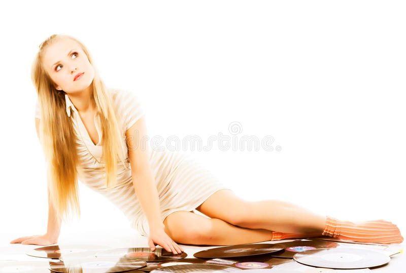 Music blond girl laying on white with vinyl records. Blond girl laying on white with vinyl records stock photography