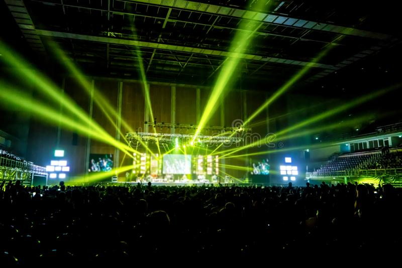Music brand showing on stage or Concert Live and Defocused entertainment concert lighting on stage with Laser rays beams, party stock photos
