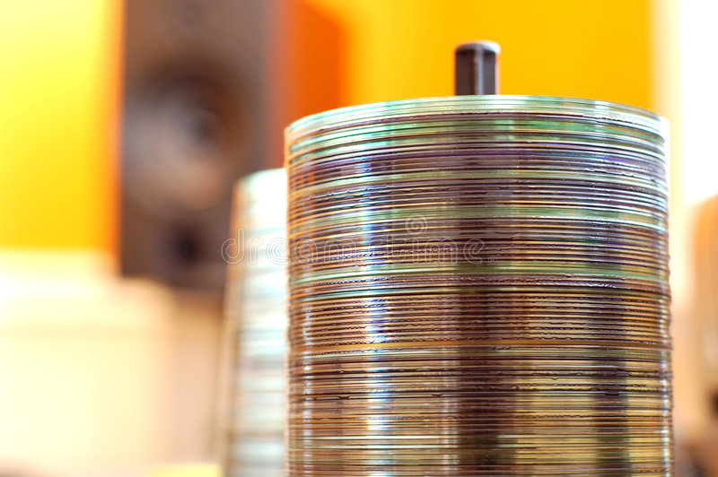 Music CD Spindle. A spindle of CDs in an audio engineering studio stock images