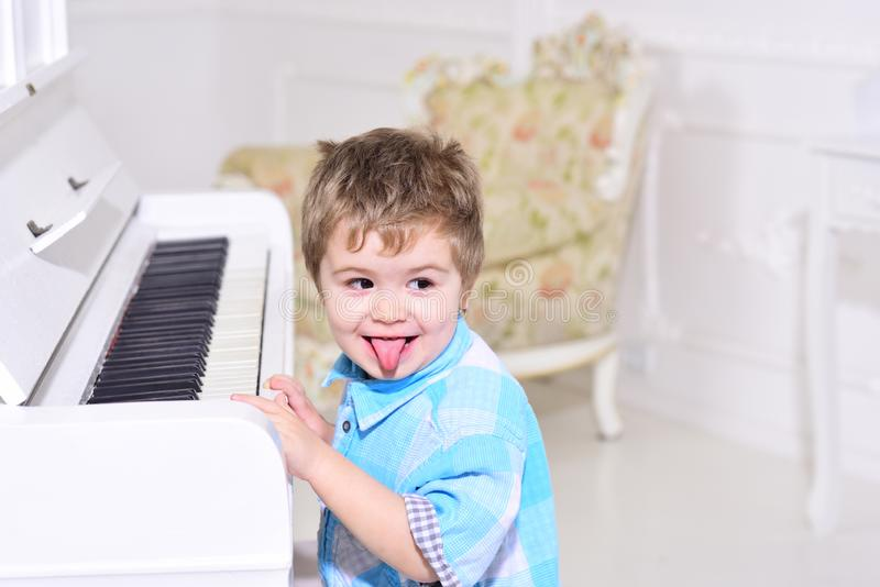 Music. child play piano. happy family and childrens day. happy childhood. Care development. Music and art education. Little boy playing piano. little boy train stock photos