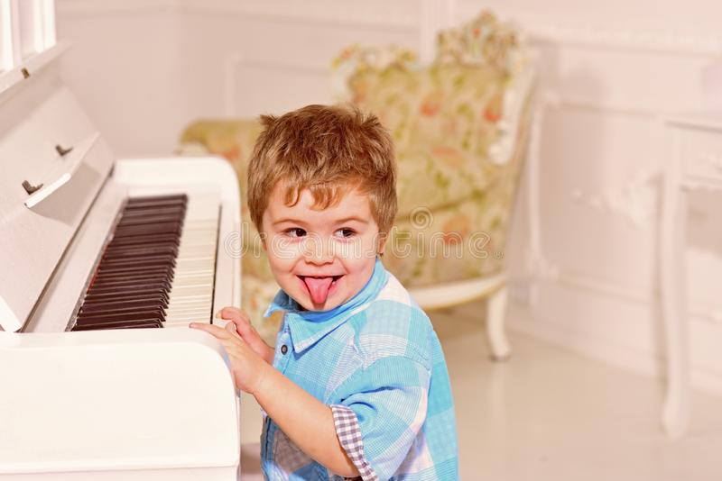 Music. child play piano. happy family and childrens day. happy childhood. Care development. Music and art education. Little boy playing piano. little boy train royalty free stock photos