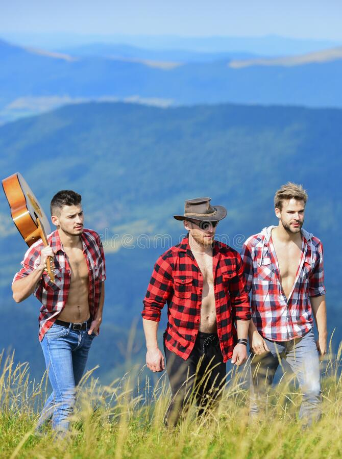 Music chose me. western camping. campfire songs. group of people spend free time together. hiking adventure. cowboy men stock photo