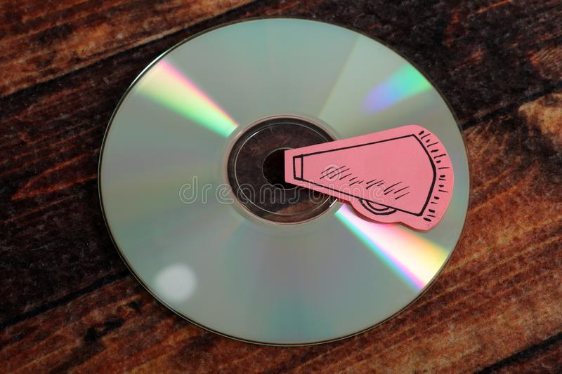 Music compact disc. Beautiful image of music compact disc on wooden background stock images