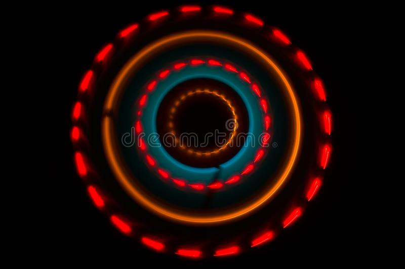 Music concept. Freezelight glowing vinyl on dark background or Turntable playing vinyl with glowing abstract lines concept on dark. Background. For Club poster stock photography