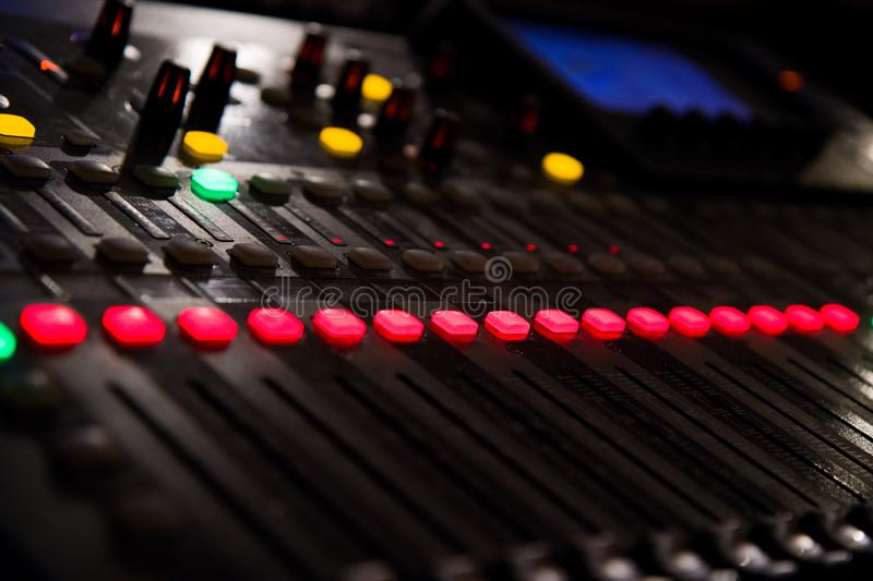 A music console with many buttons and sliders royalty free stock images