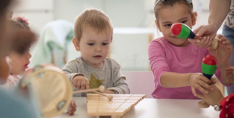 Music and creativity. Children in preschool stock photography