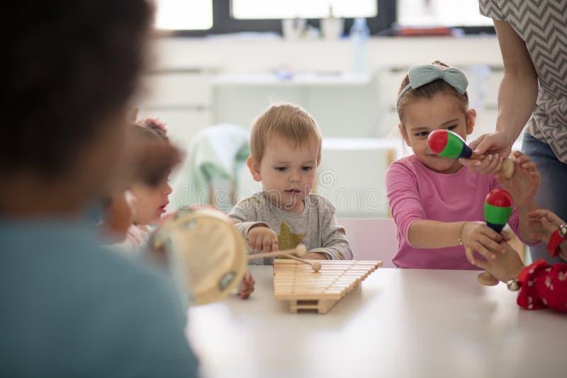 Music and creativity. Children in preschool royalty free stock image