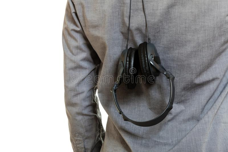 Closeup of headphones hanging upside down. Music devices, digital sound concept. Closeup of headphones hanging upside down on someone back stock photography