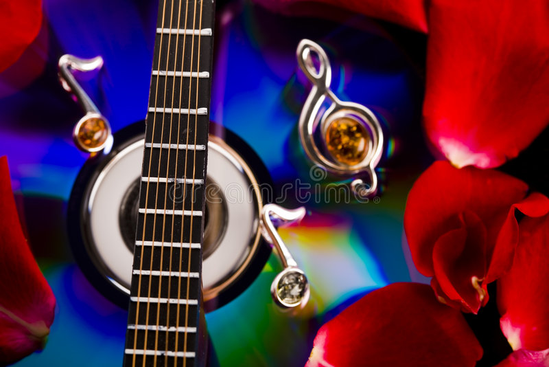 Music on disc & Guitar. Musical instrument - classic guitar and other objects royalty free stock photography