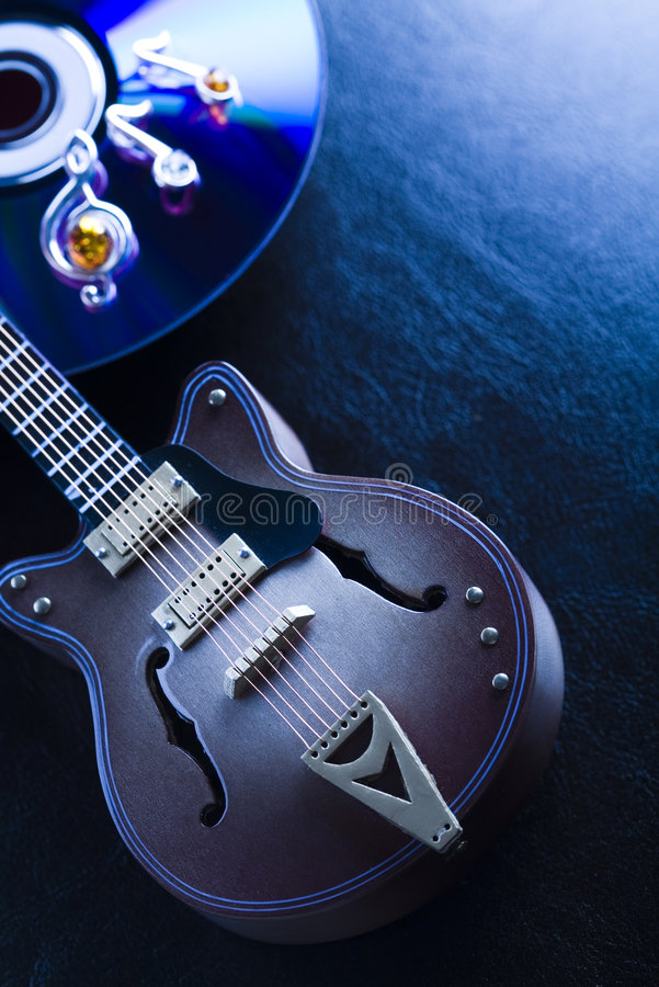 Music on disc & Guitar. Musical instrument - classic guitar and other objects royalty free stock image