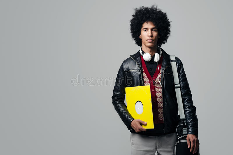 Music dj. Portrait with afro and headphones isolated on grey background royalty free stock photography