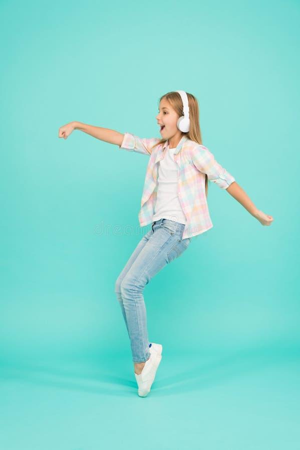 Music drives me dance. Girl child listen music with modern headphones. Kid little girl listen song headphones. Music stock image