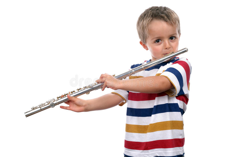 Music education. Young boy practicing on his flute on white background concept for music education stock images