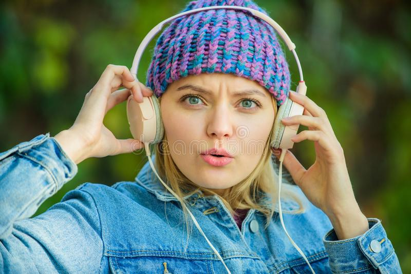 Music fan concept. Headphones must have modern gadget. Enjoy powerful sound. Feeling awesome. Cool funky girl enjoy. Music in headphones outdoor. Girl listen stock photography