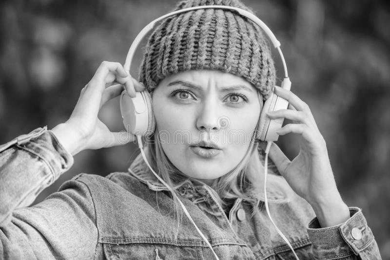 Music fan concept. Headphones must have modern gadget. Enjoy powerful sound. Feeling awesome. Cool funky girl enjoy. Music in headphones outdoor. Girl listen royalty free stock images