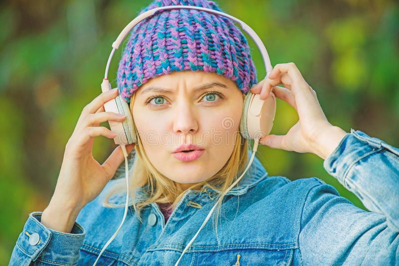Music fan concept. Headphones must have modern gadget. Enjoy powerful sound. Feeling awesome. Cool funky girl enjoy. Music in headphones outdoor. Girl listen stock images