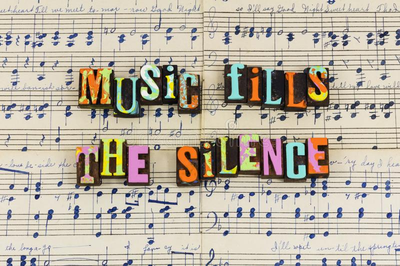 Music fills silence silent. Music awakens soul alive musical sound sounds melody notes hand drawn sheet paper song singing songs letterpress musician phrase royalty free stock photo
