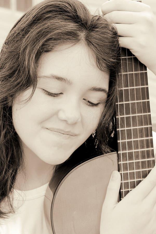 Music girl guitar stock photo