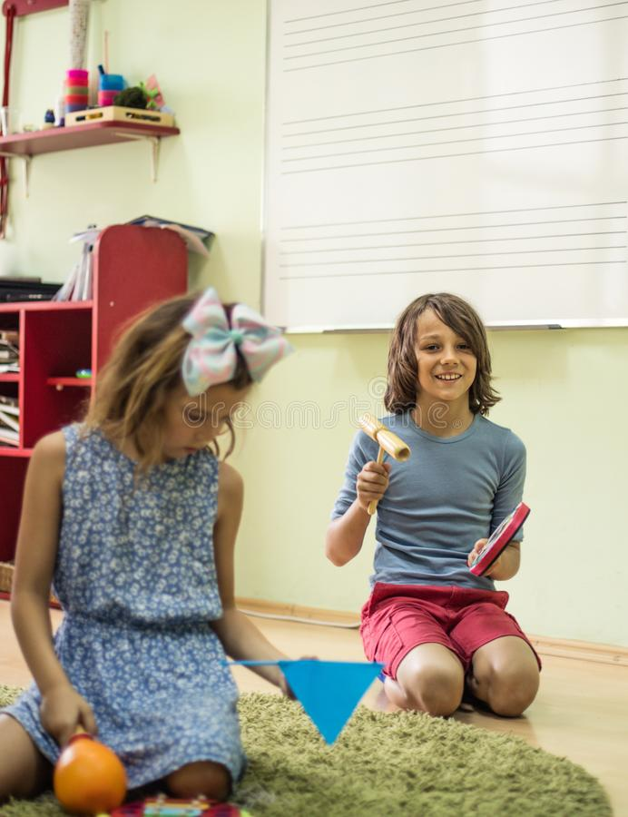 Music gives us a smile. Children in music school royalty free stock photography