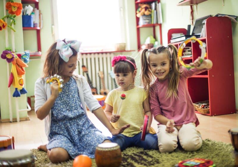 Music is good. Children in preschool royalty free stock photo