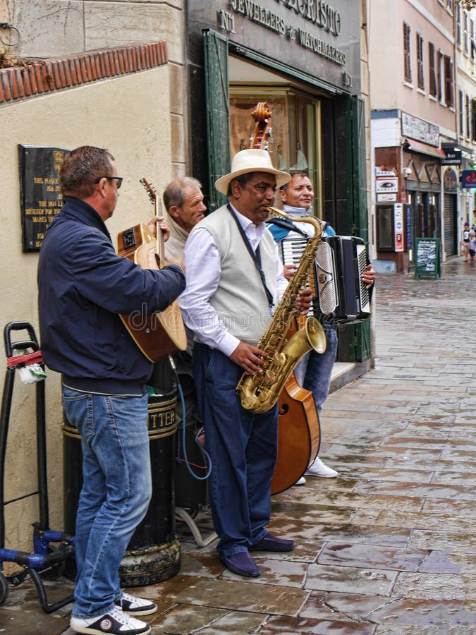 Music group paying jazz in city centre on the Rock of Gibraltar. Gibraltar is a British overseas territory located near the southernmost tip of the Iberian royalty free stock photography