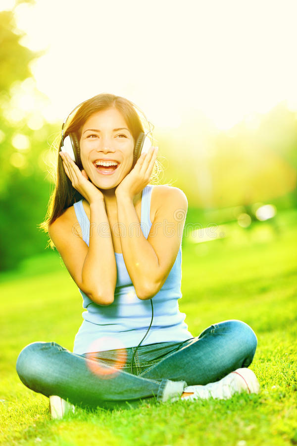 Music headphones woman in park royalty free stock images