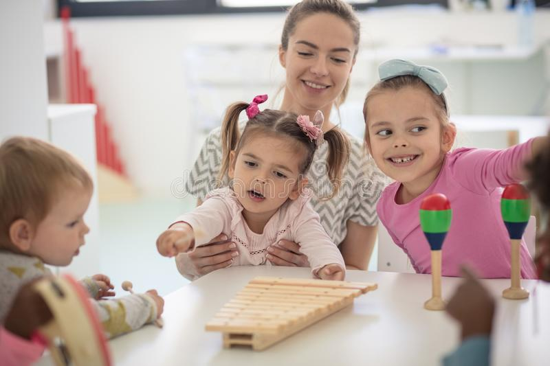 Music is important for their growing up. Children in preschool stock photography