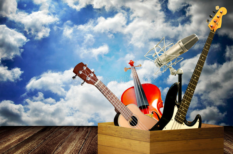 Music instrument in wooden box royalty free stock images
