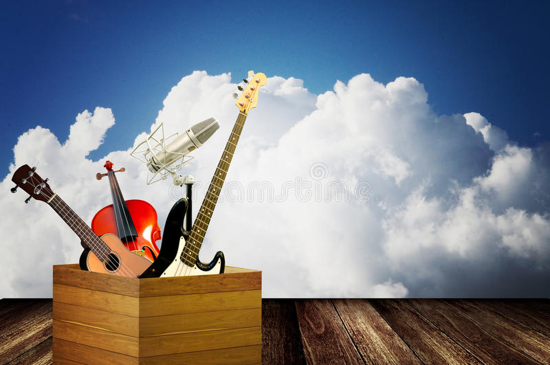 Music instrument in wooden box royalty free stock photos