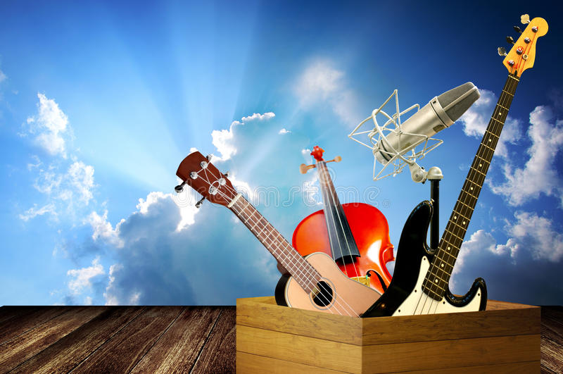 Music instrument in wooden box. With cloudy sky background royalty free stock photo