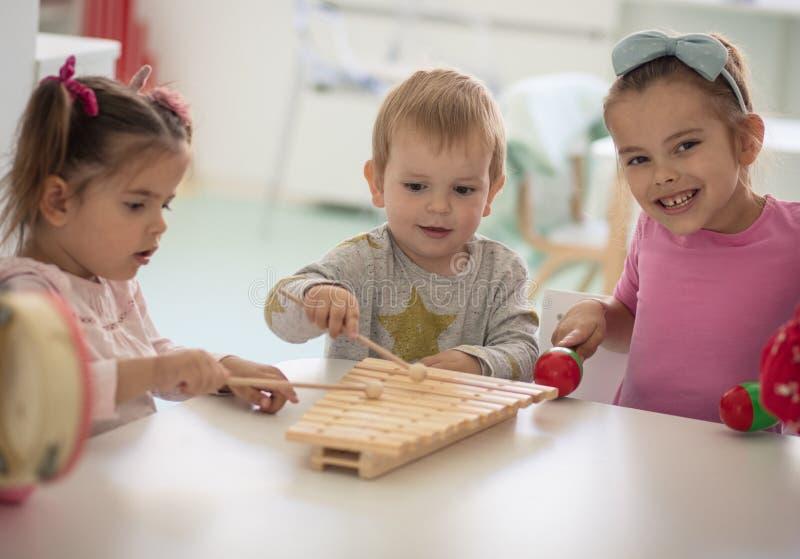 Music and joy. Children in kindergarten stock images