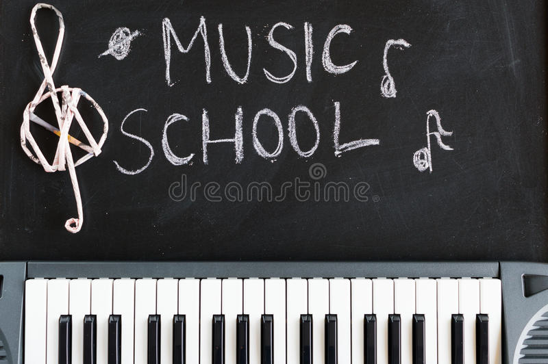 Music keyboard on blackboard background for music school children. With copy space stock photo