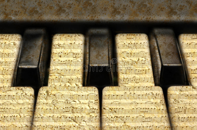 Music keyboard with grunge notes. Music keys with grunge notes texture stock photography