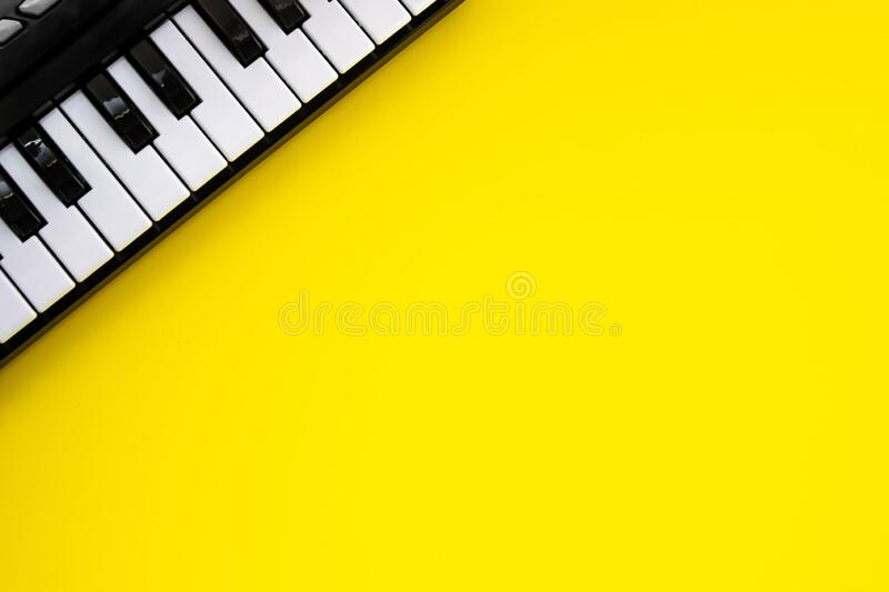 Music Keyboard over yellow background. Copy space.  stock photography