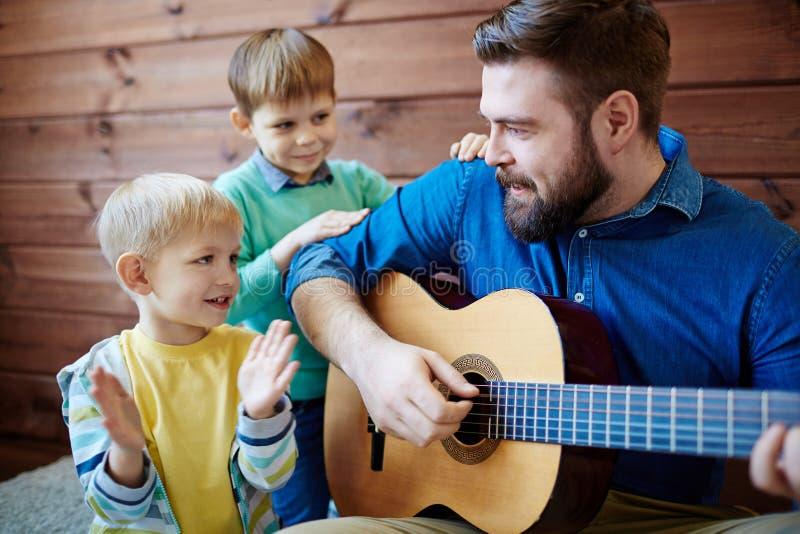 Music lesson for little boys stock photos