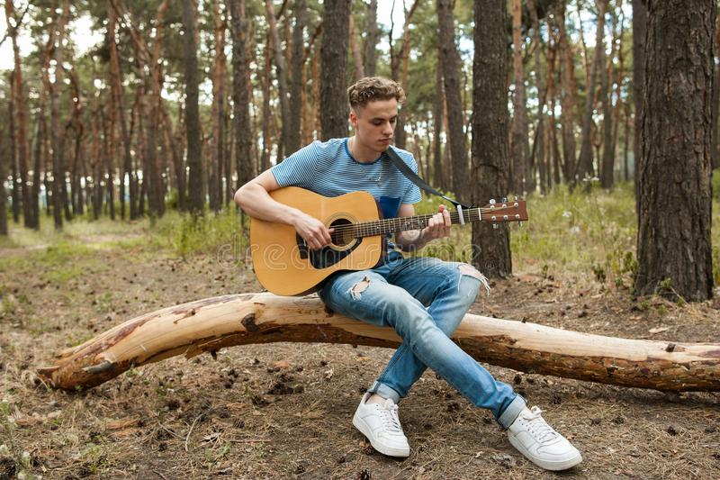 Music lifestyle man playing guitar nature concept. royalty free stock photos