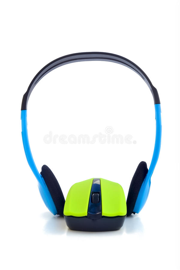 Music on line. Typical computer headphones wrapped around a computer mouse stock photos
