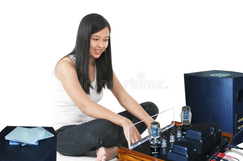 Music - Woman listening to music with sound system stock photo