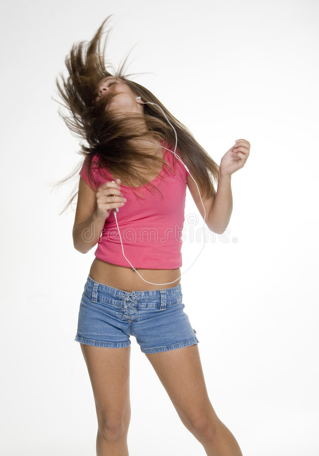 Music lover. Teenage girl dancing with her iPod royalty free stock images