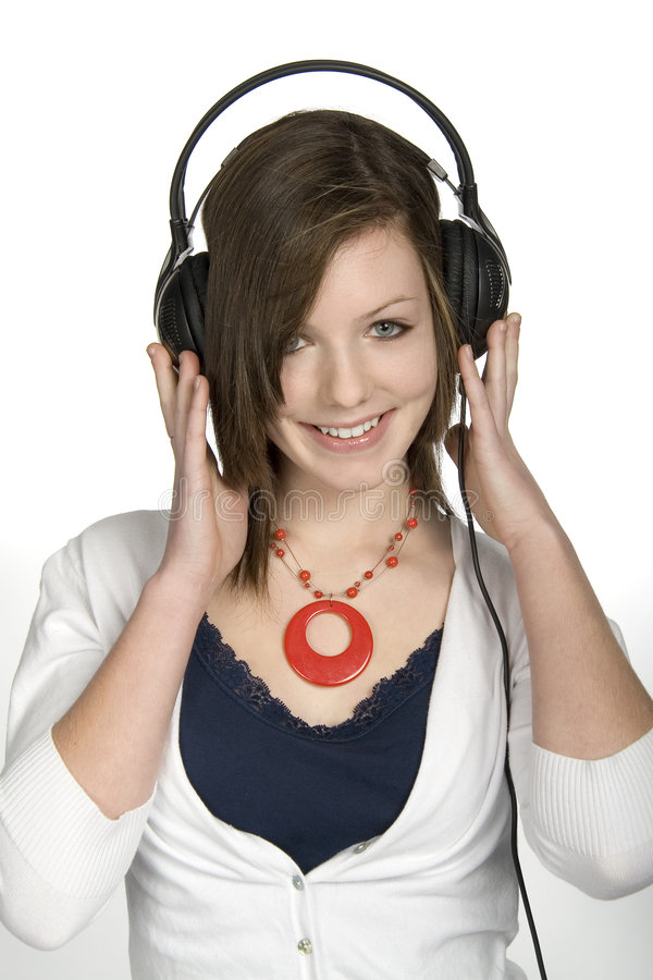 Music lover. Teen girl listening to music on headphones royalty free stock photography
